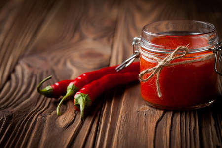 hot peppers: Homemade DIY natural hot chilli sauce sriracha Stock Photo