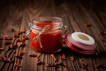 Homemade DIY natural hot chilli sauce sriracha Imagens