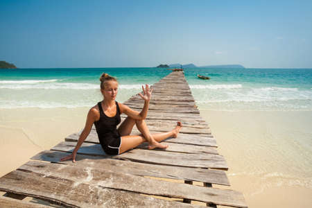 Summer yoga session on a beach - tropical Koh Rong island, Cambodia photo