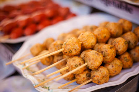 no name: Fresh fried thai no name meatballs served on a skewer. Traditional asian cuisine. Stock Photo