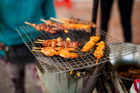 Fresh made hot barbeque satay. Traditional cambodian cuisine.