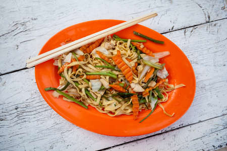 Stir fried egg noodles with chicken. Traditional khmer cuisine. photo