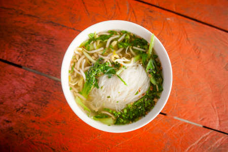 Hot cambodian broth glass noodles. Traditional khmer style soup. photo