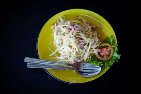 tam: Fresh made hot papaya salad Som Tam with red onion and tomatoe. Traditional thai cuisine.