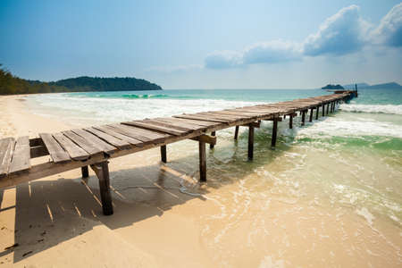 Summer seascape on tropical island Koh Rong in Cambodia. Landscape of south east Asia with wooden pier. Imagens