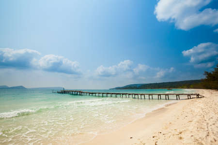 east asia: Summer seascape on tropical island Koh Rong in Cambodia. Landscape of south east Asia with wooden pier. Stock Photo