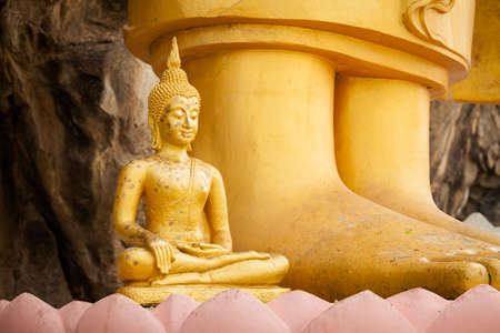 east asia: Sculpture of gold thai Buddha in Hua Hin in Thailand. Religion symbol of south east Asia. Stock Photo