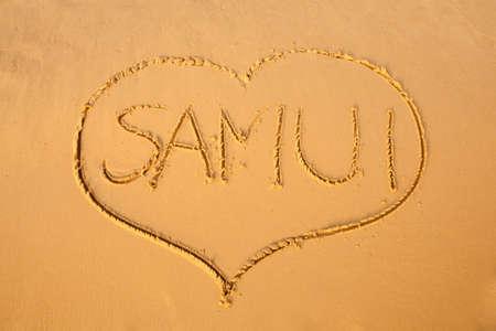 Word Samui signed on beach. South east Asia symbols. photo