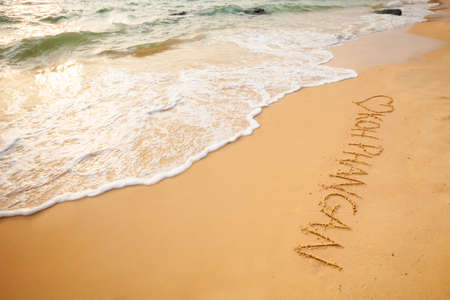 east asia: Word Koh Phangan signed on beach. South east Asia symbols. Stock Photo