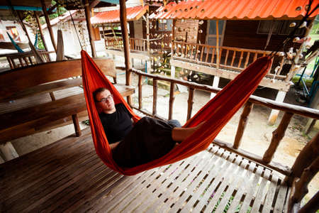 Young woman in hammock on tropical island Koh Phangan in Thailand. Chalokum beach resort. photo