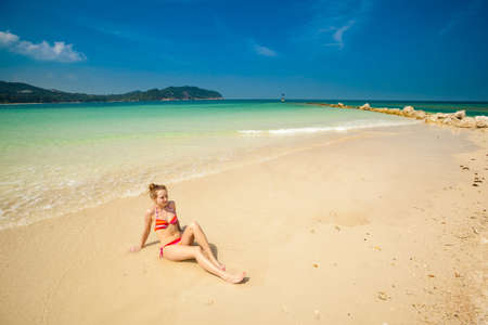 Young girl on tropical island Koh Phangan in Thailand. Tourist on Chalokum beach. photo