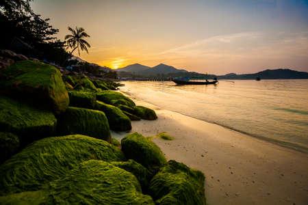 Beautiful sunset on tropical island Koh Phangan in Thailand. Chalokum beach landscape.
