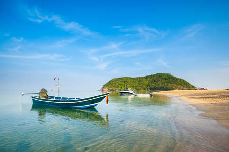 Summer seascape on tropical island Koh Phangan in Thailand. Mae Haad beach and Koh Ma landscape. photo