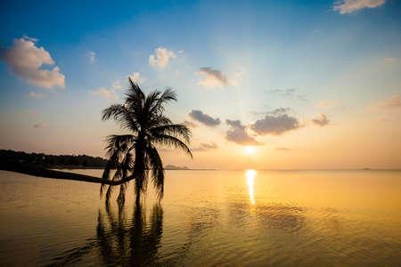 Beautiful sunset on tropical island Koh Phangan in Thailand. Asian beach landscape. photo