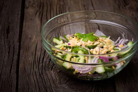 thai pepper: Homemade DIY natural thai green cucumber salad with red onion, sweet sauce, coriander, chilli and peanuts