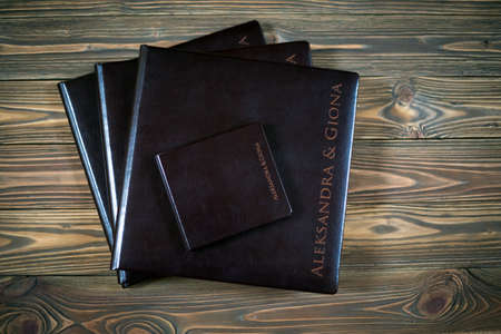 wedding photo album: Closeup of opened book pages. Wedding photo album detail  Education concept.
