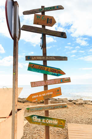 Oldschool guidepost on Las Americas Beach on summer seascape on tropical island Tenerife, Canary in Spain. Playa de Las Americas