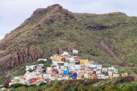 santa cruz de tenerife: Summer cityscape on tropical island Tenerife, Canary in Spain. View on capital City Santa Cruz de Tenerife on mountain slope.