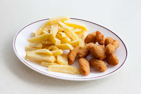 scampi: Traditional english meal - deep fried seafood, scampi with chips served in local restaurant in Hastings, England.