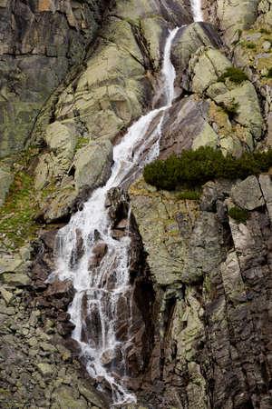 tatry: Beautiful Skok vodospad in slovakian Tatry mountains. Panorama of mlynicka valley. Stock Photo