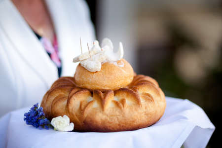 invitando: Wedding bread with salt detail on hands - traditional polish inviting to Bride and Groom.