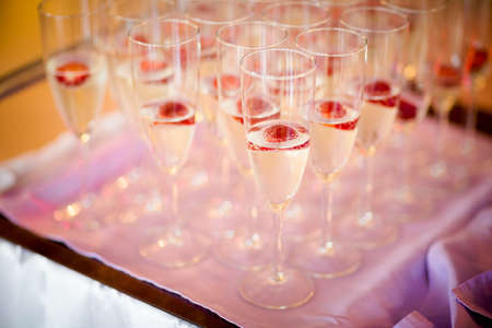 Wedding sparkling wine, champagne detail - traditional toast inviting to Bride and Groom.