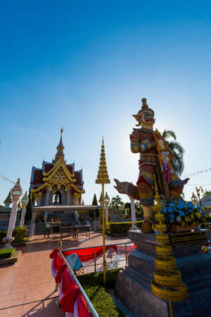 Beautiful buddhist Thao Kuvera demon monument and City Pillar Shrine temple in Udon Thani in northern Thailand. Cityscape with beautiful religion architecture of south east Asia.