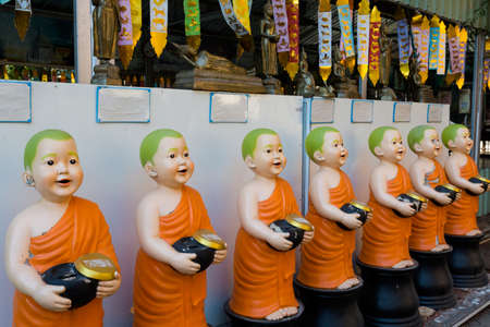 Beautiful buddhist Wat Lok Molee temple in Chiang Mai in northern Thailand. Smiling monks sculptures in south east Asia.