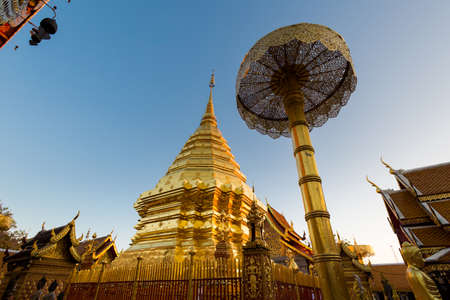 Beautiful buddhist Wat Phra That Doi Suthep temple in Chiang Mai in northern Thailand. Pictures of religion architecture in south east Asia during sunrise.