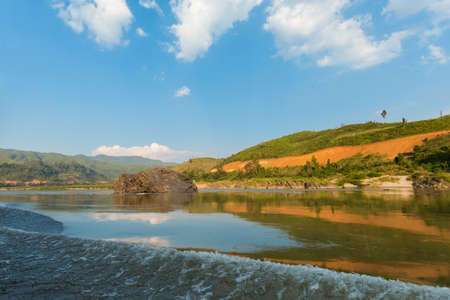 Beautiful landscape taken during two day cruise on Mekong River from Huay Xai via Pakbeng to Luang Prabang in Laos. Touristic trip trough south east Asia. Stock Photo