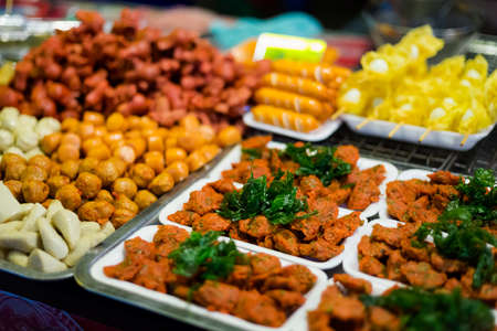Selection of thai snacks on local market. Traditional thai streetfood cuisine made of fresh ingredients.