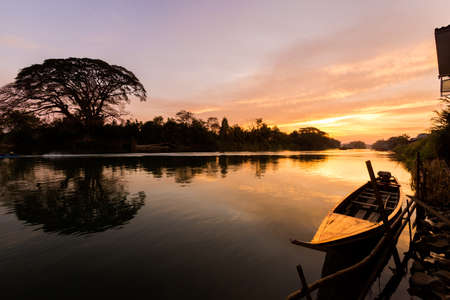 Beautiful golden sunrise on Don Det in south Laos. Landscape of nature taken on four thousands islands Si Phan Don on Mekhong river in south east asia during summer morning.