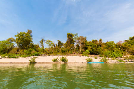 Rare irawaddy dolphins boat trip from Khongyai beach on Don Khone island in south Laos. Landscape taken from boat on four thousands islands on Mekhong river in south east asia during summer. Stock Photo