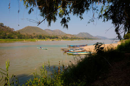 Wide Mekhong river taken in touristic Luang Prabang in Laos. Colorful scenery of south east Asia.
