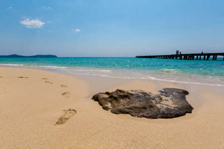 Summer landscape on tropical Koh Kood island in Thailand. Footprints on sand and landscape with sea taken from Ao Tapao beach. Stock Photo