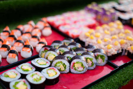 Fresh prepared asian streetfood selection of sushi. Traditional thai cuisine made of fresh ingredients.