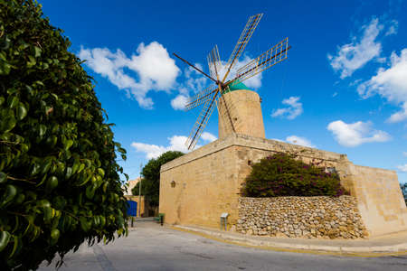 Old sandstone windmill on Gozo island. Historical architecture of Malta.