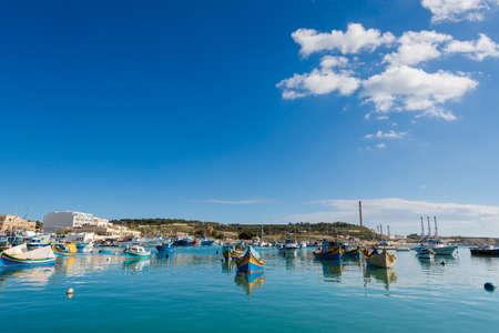 Colorful touristic landscape of Port in Marsaxlokk on Malta island. Beautiful seascape in south Europe. Stock Photo