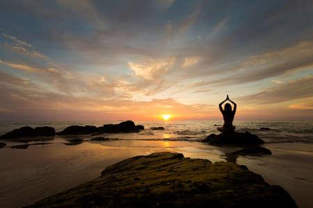 Tropical summer yoga session on beautiful sunset beach, Koh Kradan island in Thailand. Meditation - lotus pose - padma asana