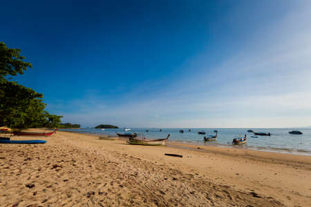Beautiful view on Klong Muang beach in Krabi, Thailand. Landscape taken close to Ao Nang with blue sky and yellow sand.