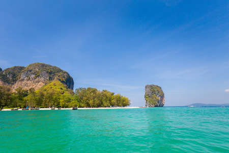 Longtail boats on tropical koh Poda island in Thailand. Landscape taken in national park in south east Asia.
