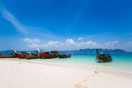 Longtail boat on tropical koh Poda island in Thailand. Landscape taken in national park in south east Asia.