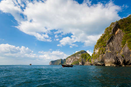 Emerald Cave (Tham Morakot) on tropical Koh Mook island in Thailand. Landscape taken from longtailboat on the sea