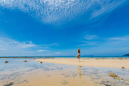 Landscape with young tourist on tropical Tioman island in Malaysia. Beautiful seascape of south east asia on Tekek beach.