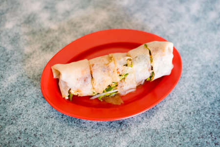 Fresh prepared malaysian spring roll Poh Piah pancake served in local restaurant in Malacca. Traditional asian cuisine made of fresh ingredients.