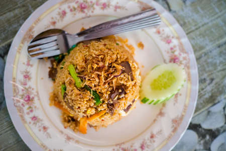 Fresh prepared malaysia beef nasi goreng daging served in local restaurant on Langkawi island. Traditional asian cuisine made of fresh ingredients. Stock Photo