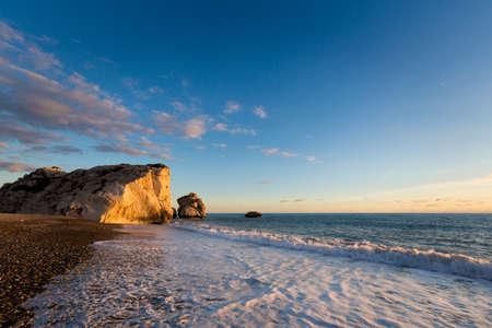 Beautiful Aphrodites rock on stone beach during susnet. Landscape taken on Cyprus island. Фото со стока