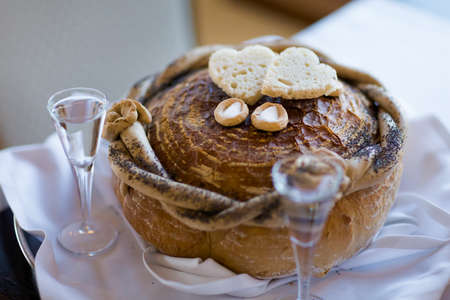 Wedding bread with salt detail on hands- traditional polish inviting to Bride and Groom.