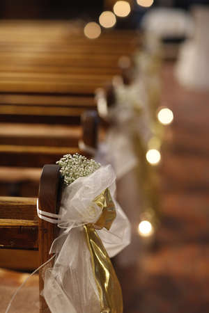 Christian detaill - church decoration for wedding marriage ceremony. Romantic floral concept.