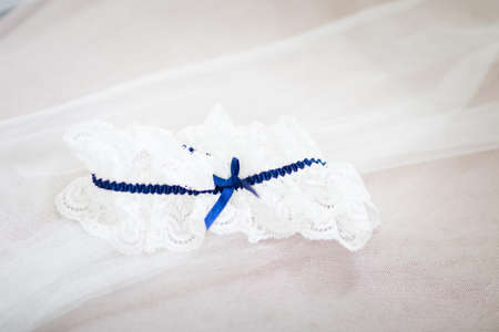 Beautiful stocking garter of the Bride before wedding - romantic suspender detail